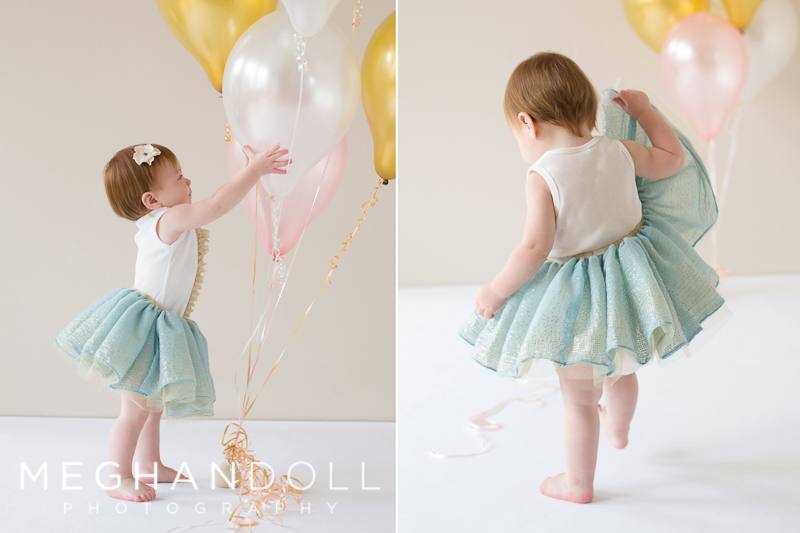little-one-year-old-girl-in-teal-tutu-dances-around-with-her-balloons