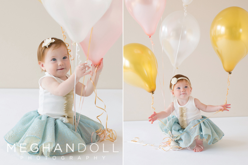 silly-little-one-year-old-baby-girl-plays-with-her-birthday-balloons