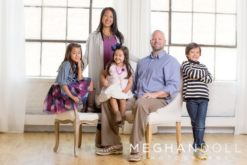 dashing-family-in-purple-poses-for-camera