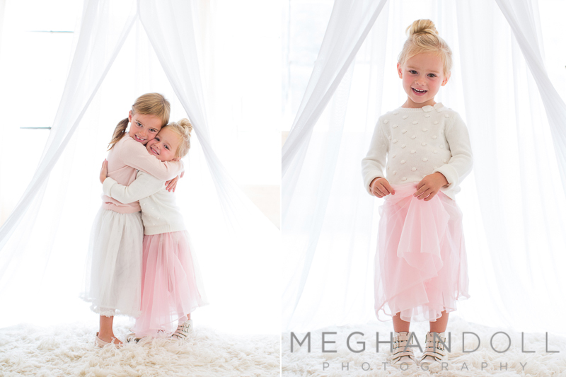 sweet-sisters-in-puffy-skirts-hug-each-other-in-canopy