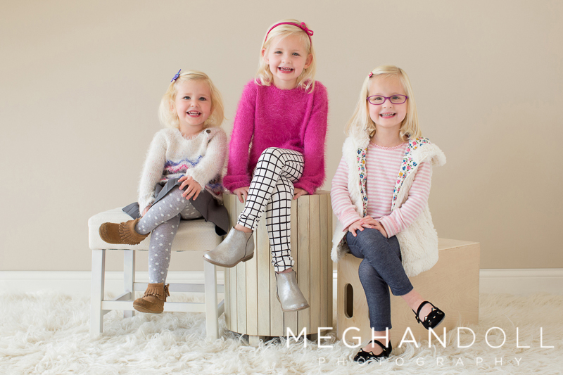 three-cute-little-sisters-pose-and-smile