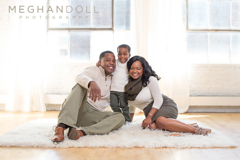 sweet-family-of-three-relaxes-on-rug