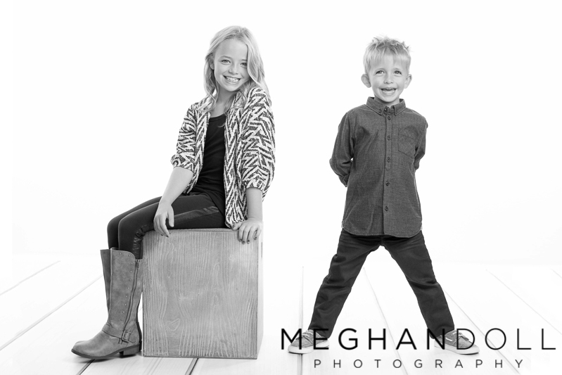 silly-boy-and-girl-laugh-for-the-camera-on-white-background