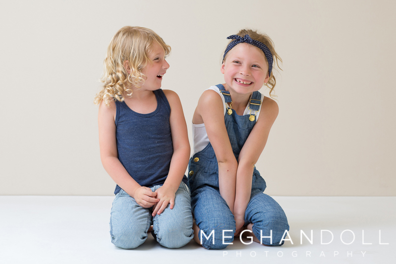 sweet-cousins-laugh-together-in-denim