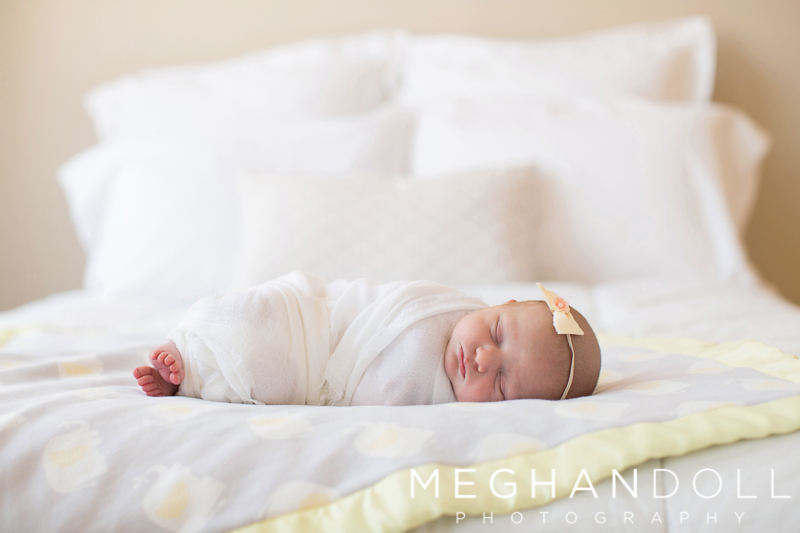 little-newborn-girl-sleeps-on-big-bed