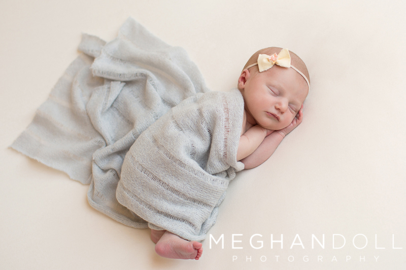 sweet-new-baby-in-gray-sleeps-on-blanket