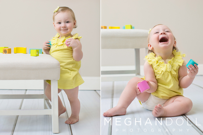 one-year-old-girl-in-yellow-plays-with-blocks