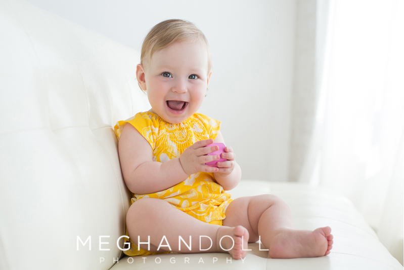 smiley-one-year-old-girl-in-yellow