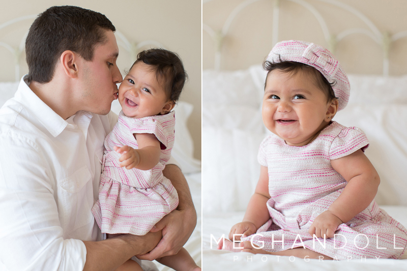 dad-kisses-his-little-six-month-baby-girl-in-pink