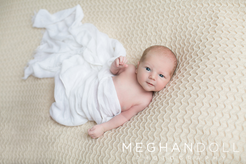 little-newborn-baby-boy-in-white-wrap