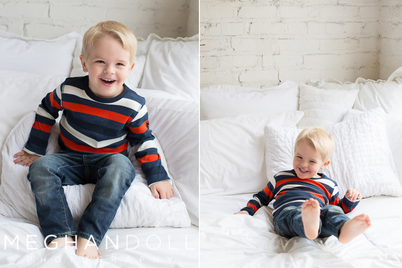 three-year-old-in-stripes-jumps-on-bed