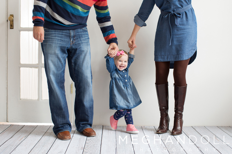 little-one-year-old-girl-in-denim-walks-with-parents