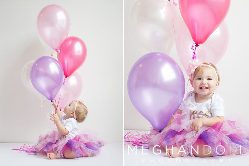 one-year-old-girl-in-pink-and-purple-with-balloons