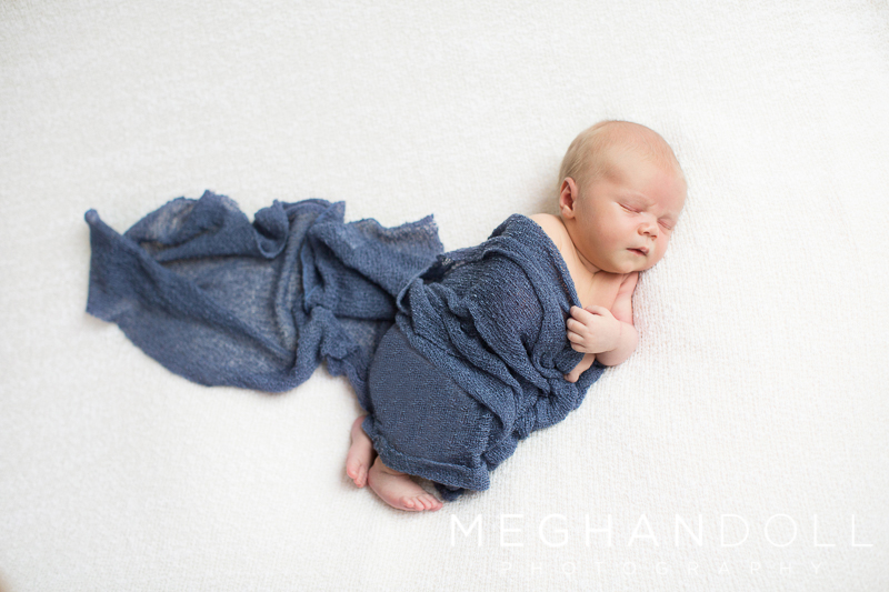 little-boy-in-blue-wrap-on-big-white-blanket