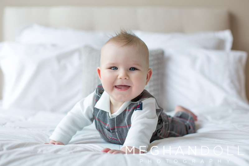 six-month-old-boy-on-his-belly-on-bed