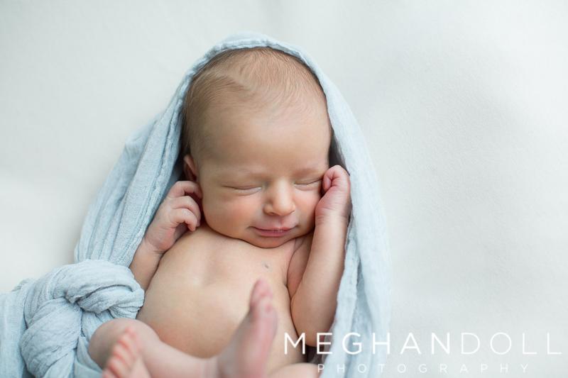close-up-of-newborn-boy-in-light-blue