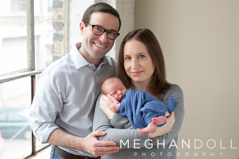 mom-and-dad-hold-newborn-son