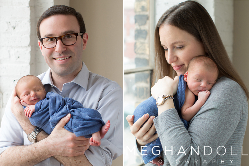 mom-and-dad-hold-sleeping-smiling-baby-boy