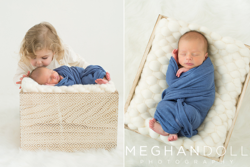 new-big-sister-kisses-baby-brother-in-basket