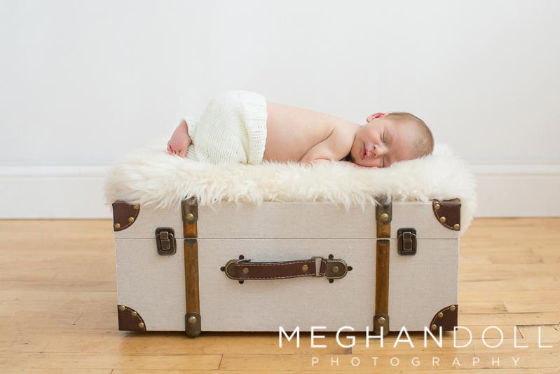 newborn-boy-on-suitcase