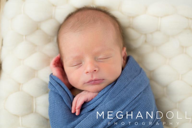 sweet-newborn-boy-sleeps-in-blue