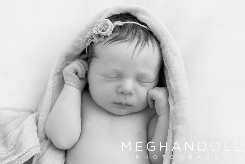 little-newborn-girl-sleeping-in-wrap