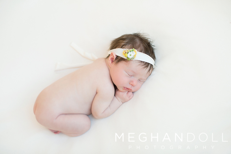 sweet-newborn-girl-with-green-and-yellow-headband