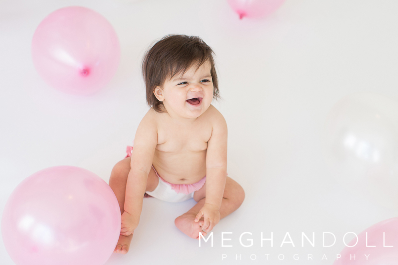 one-year-old-girl-laughs-with-balloons