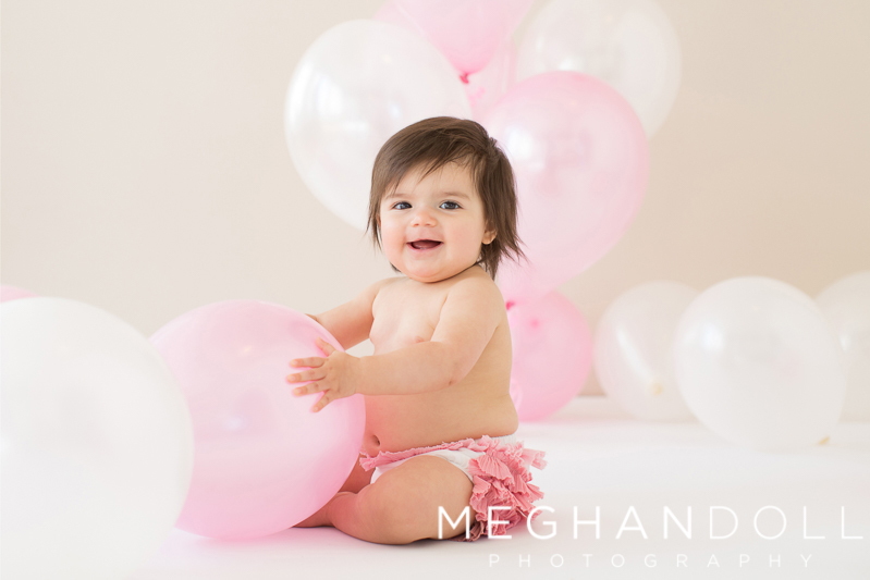 one-year-old-girl-plays-with-balloons