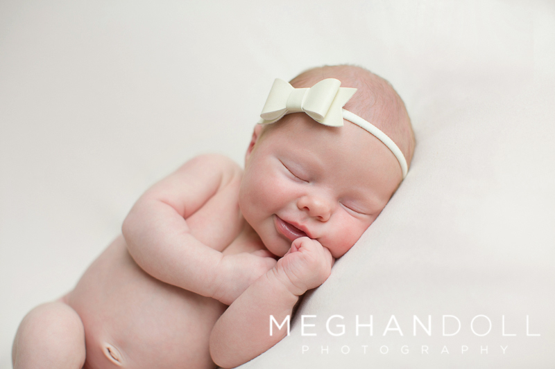 Chubby-newborn-baby-with-cute-bow1.jpg