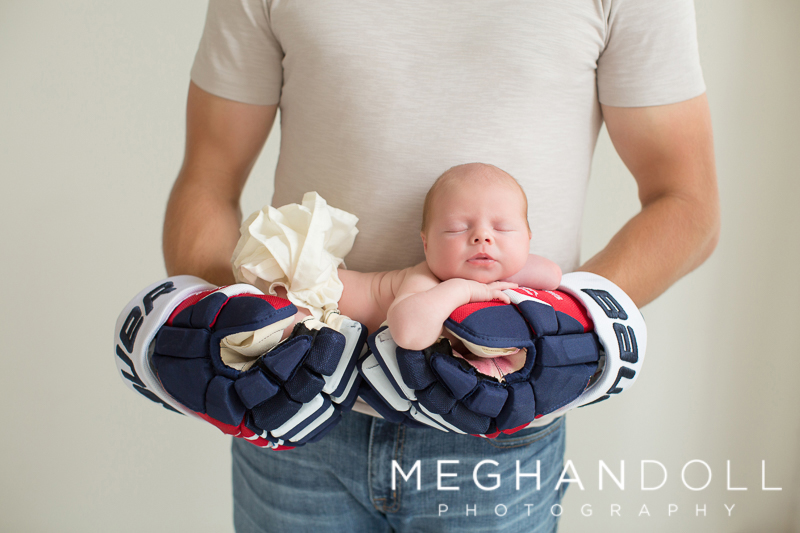 hocky-dad-holding-baby-in-gloves.jpg