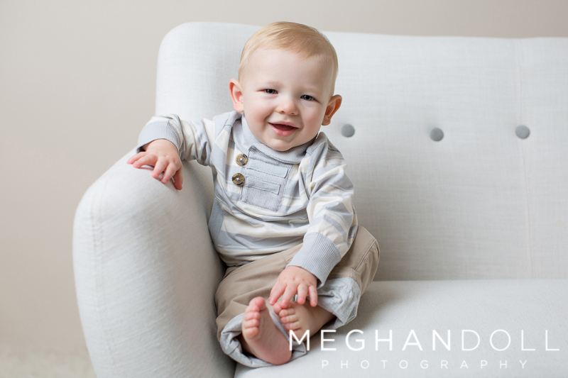 one-year-old-boy-in-gray-on-button-couch