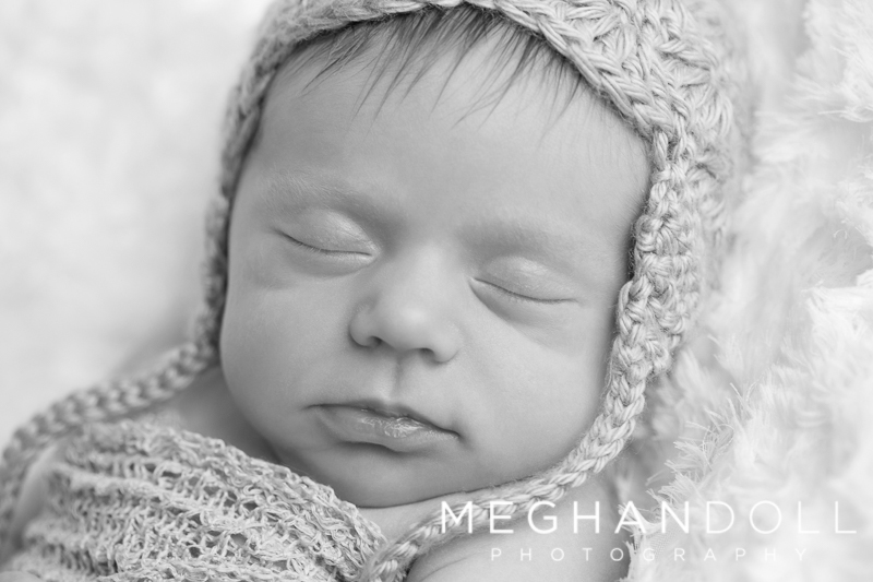 sleeping-newborn-girl-in-hat