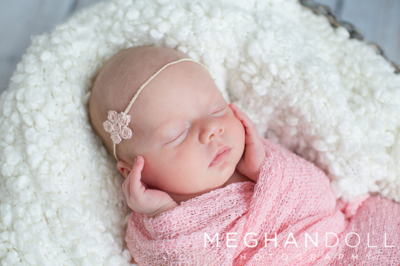 twin-newborn-girl-in-light-pink