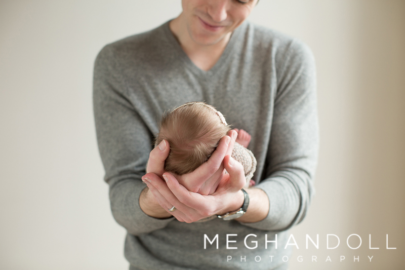 Father-holding-newborn-baby