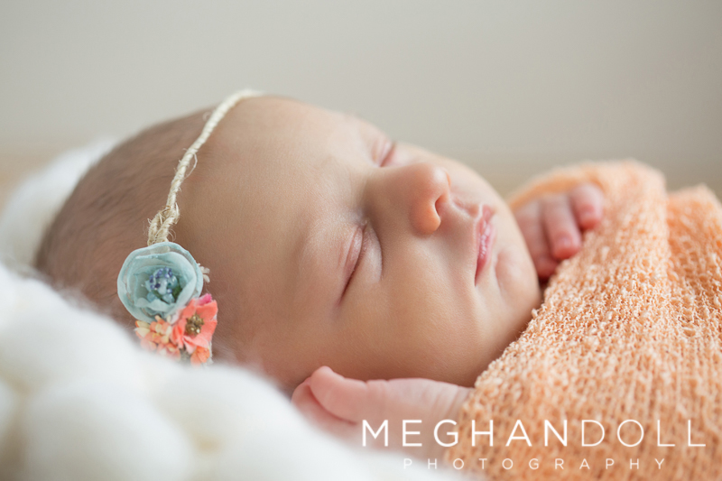 close-up-of-newborn-girl-in-orange