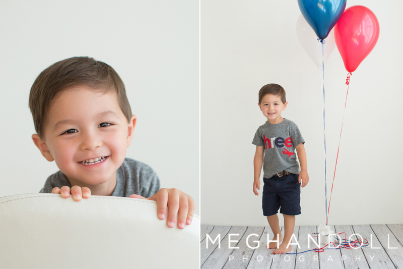 boy-peeking-over-chair-and-standing-next-to-balloons