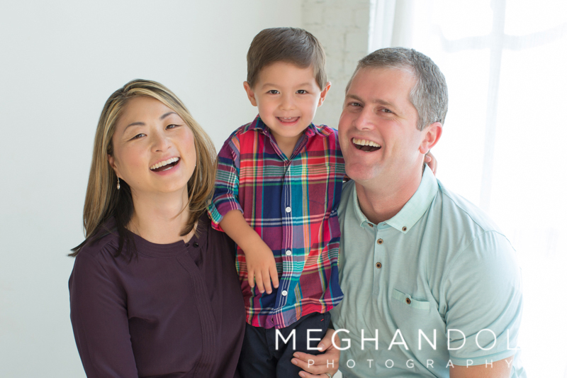 mom-and-dad-with-three-year-old-laughing