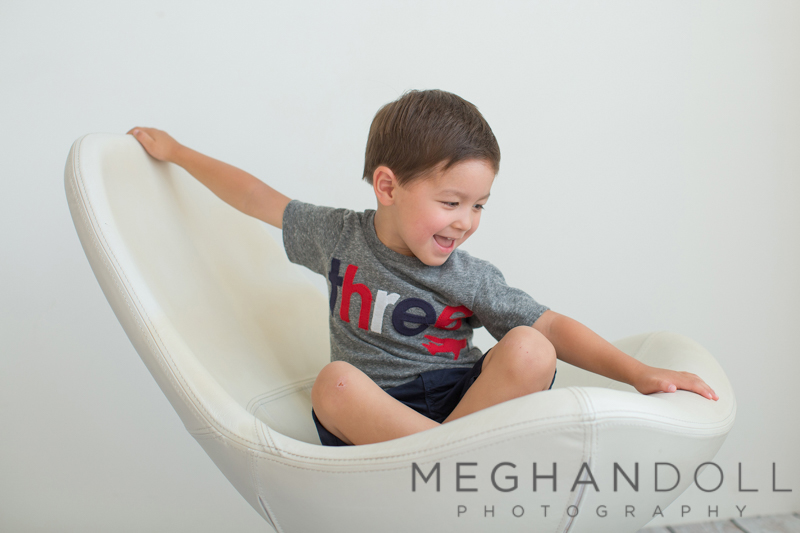 three-year-old-sitting-on-egg-shaped-chair
