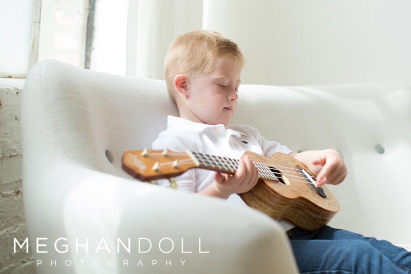 boy-sitting-in-chair-playing-guitar.jpg