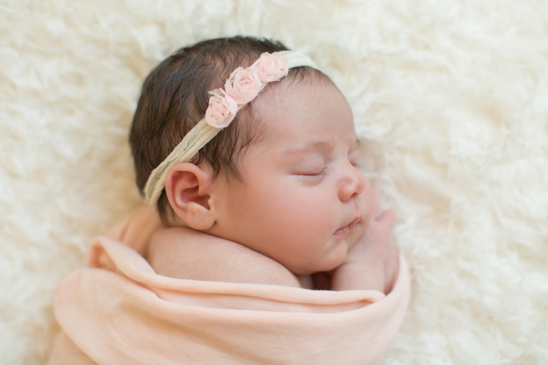 baby-girl-laying-in-peach-blanket.jpg