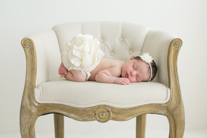 baby-laying-on-cream-chair.jpg