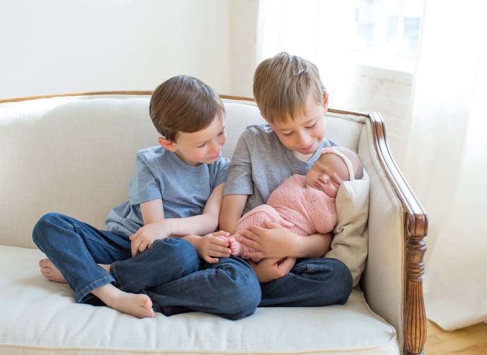 two-brothers-holding-baby-sister.jpg