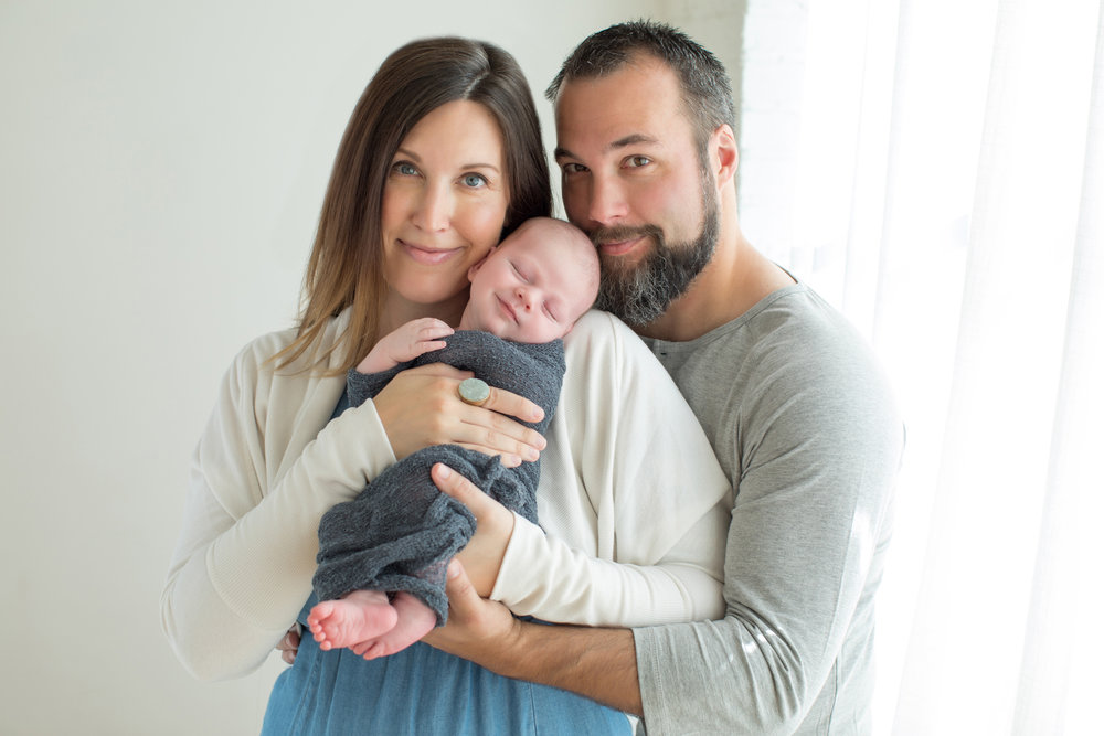 Happy_Family_Welcomes_Newborn.jpg
