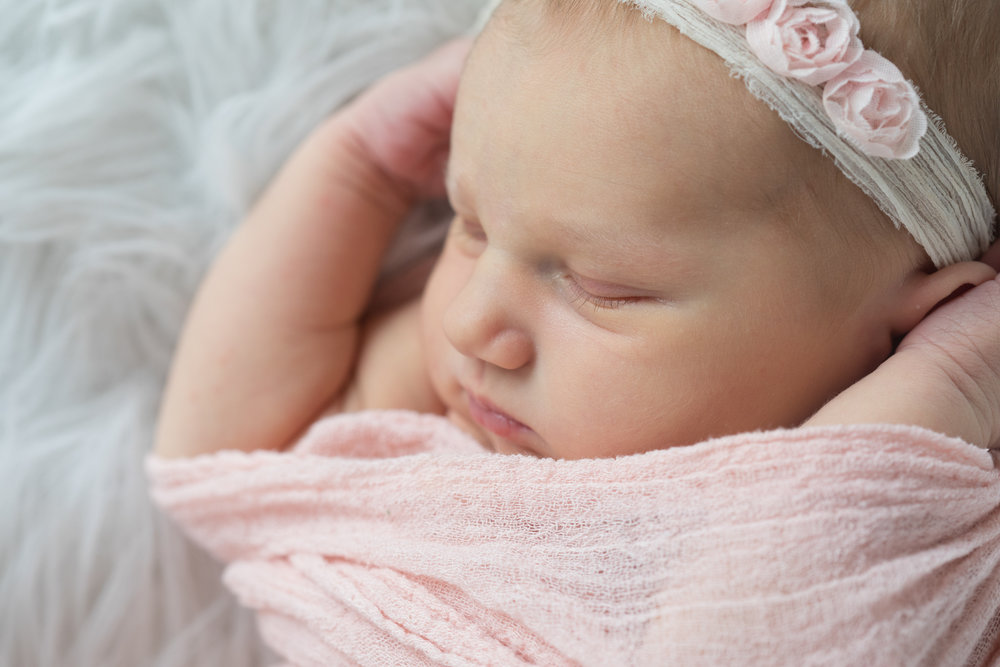 Newborn_Girl_Wrapped_In_Pink.jpg