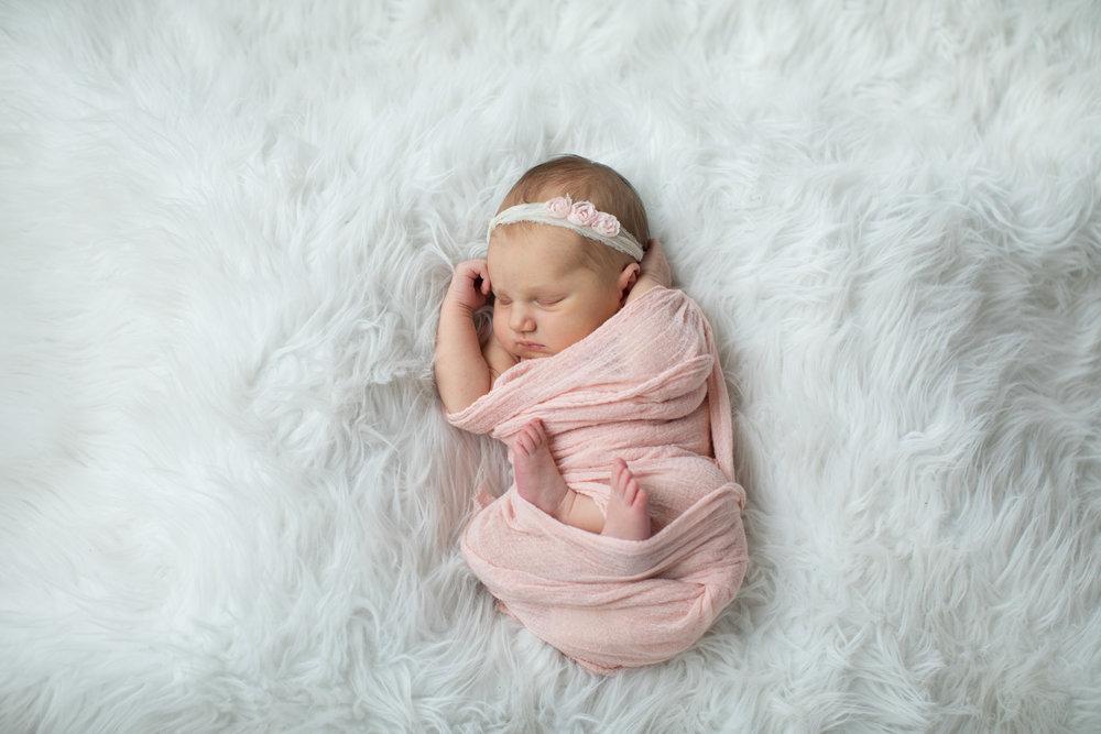 Newborn_Girl_On_White_Carpet.jpg