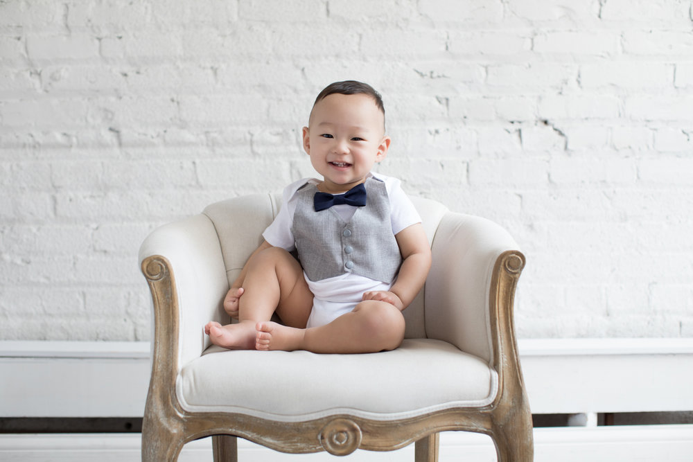 Boy_In_Bow_Tie_Sitting_In_Chair.jpg