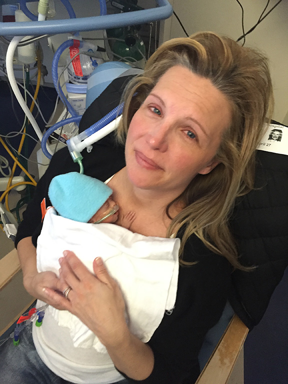 April 2016 - Lori and Charlie (24 days old). Mom finally gets to hold one of her babies.