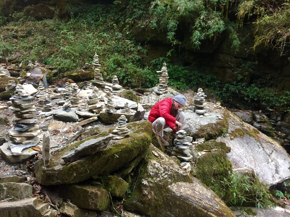 A groovy lil' photo of my groovy lil' daughter Bella returning to her practice of building rock castles during an interlude whilst trekking the Annapurna circuit in Nepal a few years back.