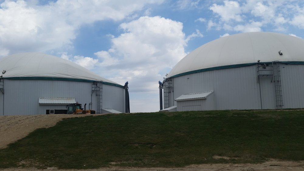 The holding tanks here are filled with liquid manure and covered. The covered tanks do a good job containing any odor.